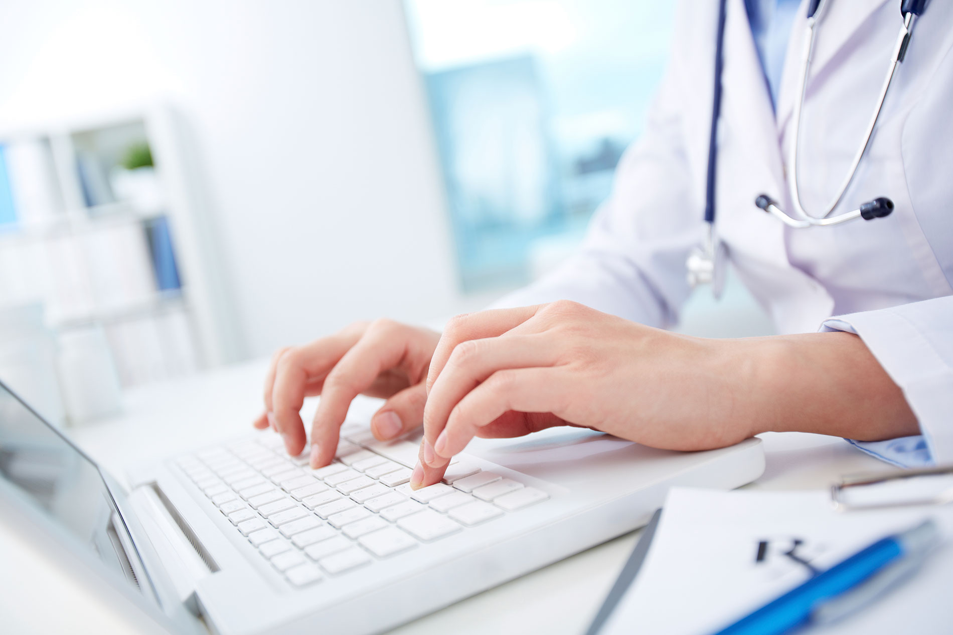 urgent-care-doctor-typing-notes