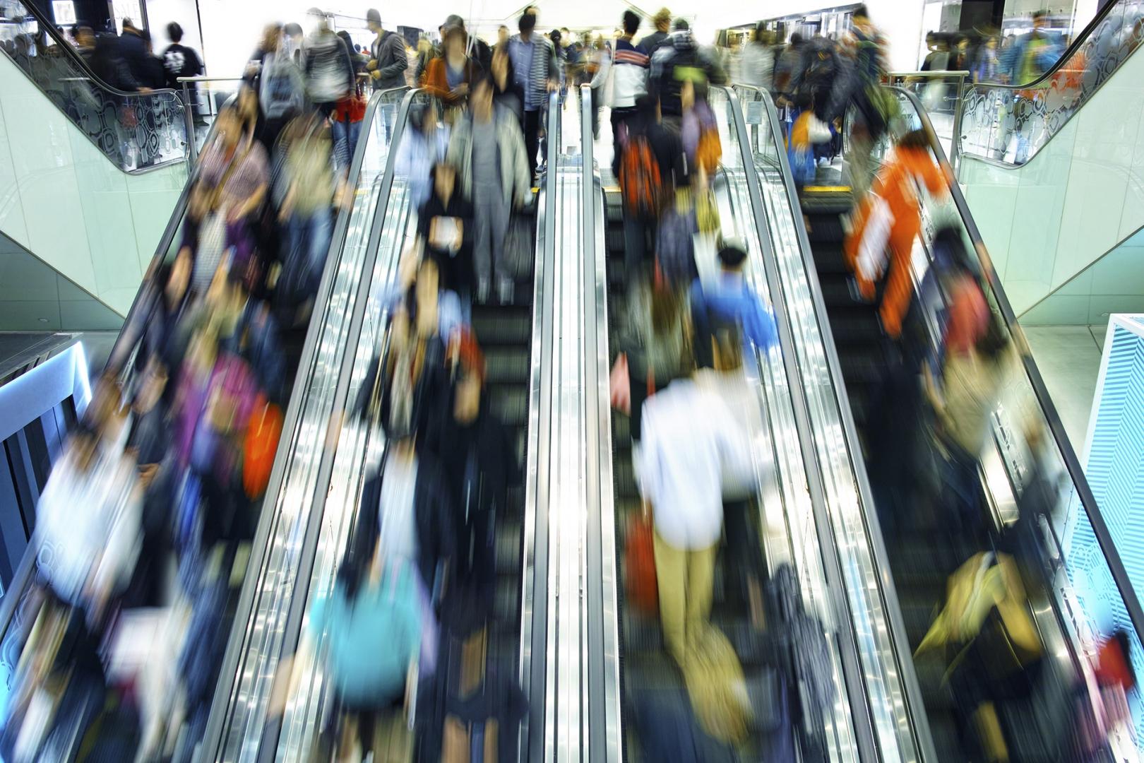 customers riding escalator