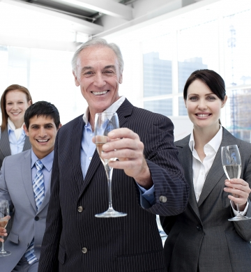 business people toasting with champagne