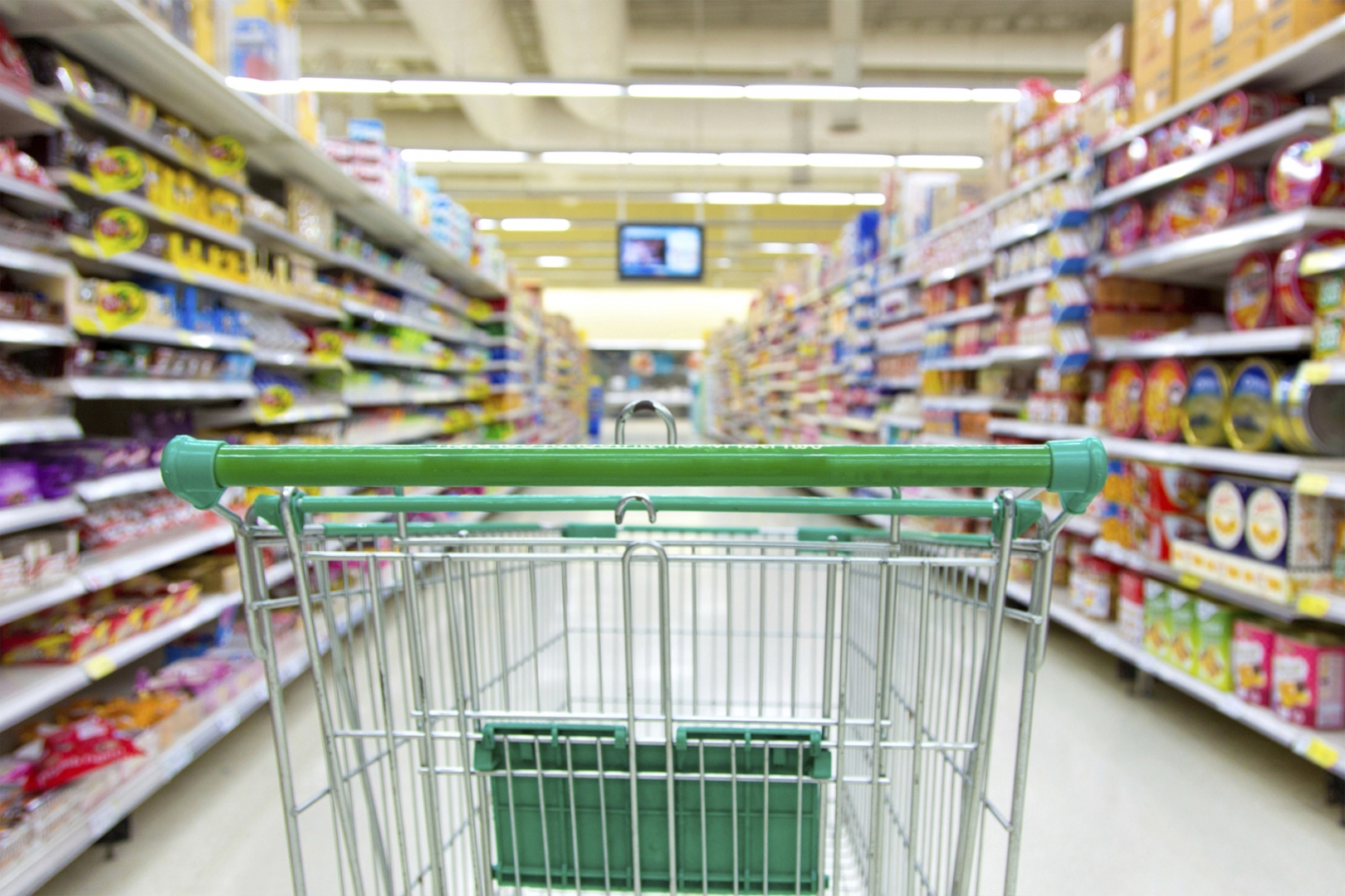 cart being pushed by customer in a grocery store