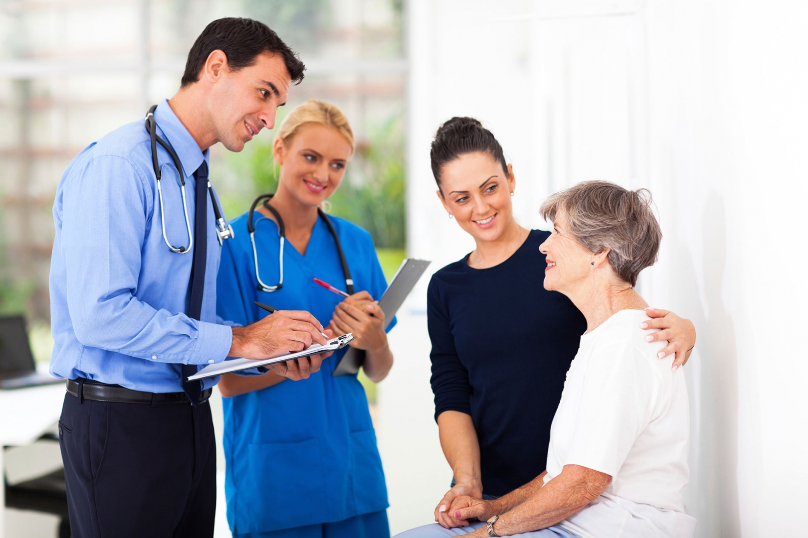 A doctor and nurse meet with a patient