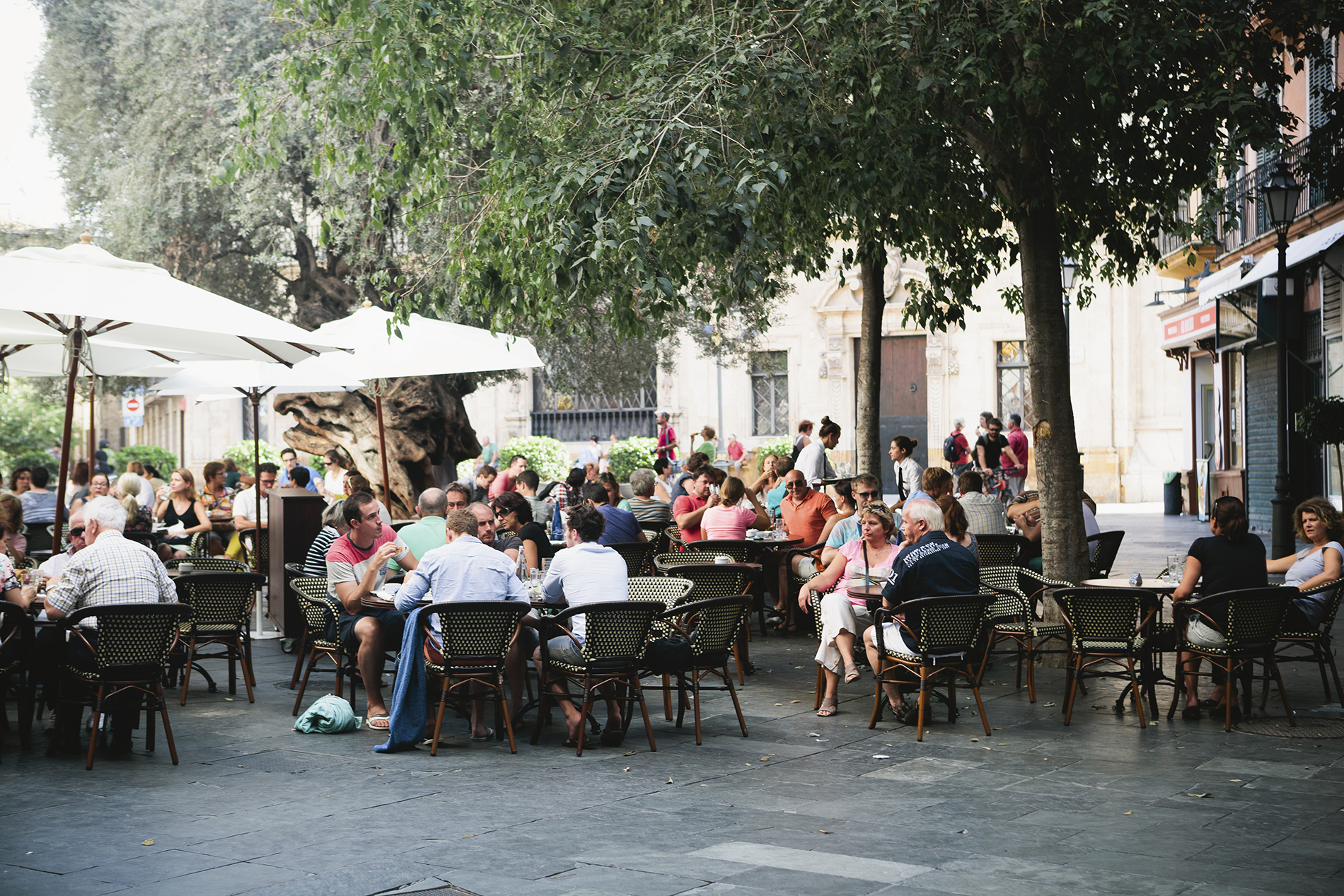 numerous tables of customers dining outside