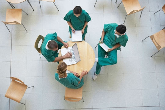 doctors reviewing information around a small table