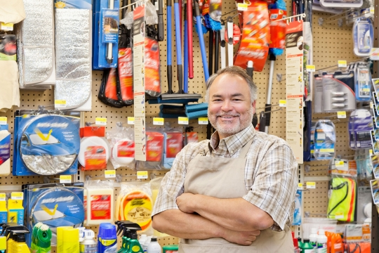 Retail franchisee standing in his hardware store