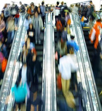 customers on an escalator