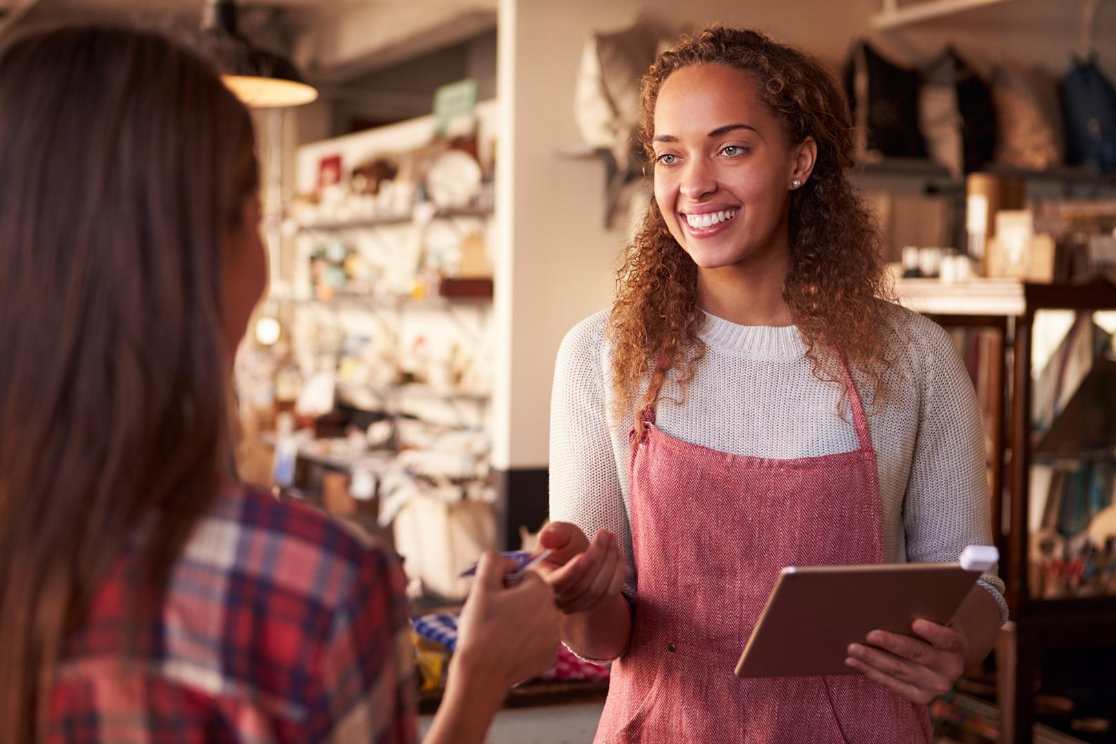 loyal customer purchasing goods at retailer