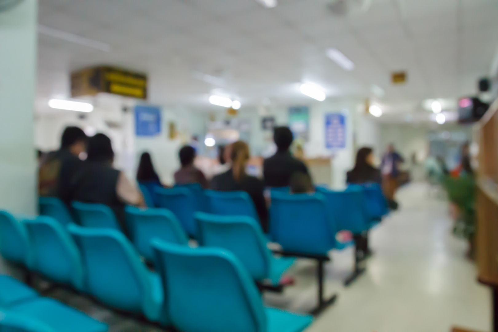 Patients waiting in a clinic waiting room