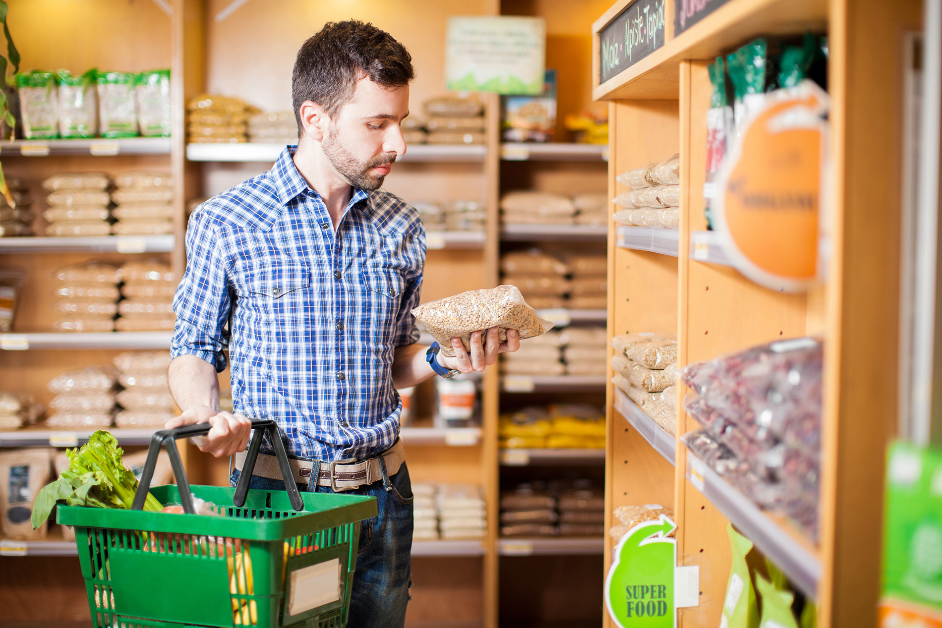 man shopping at specialty grocer