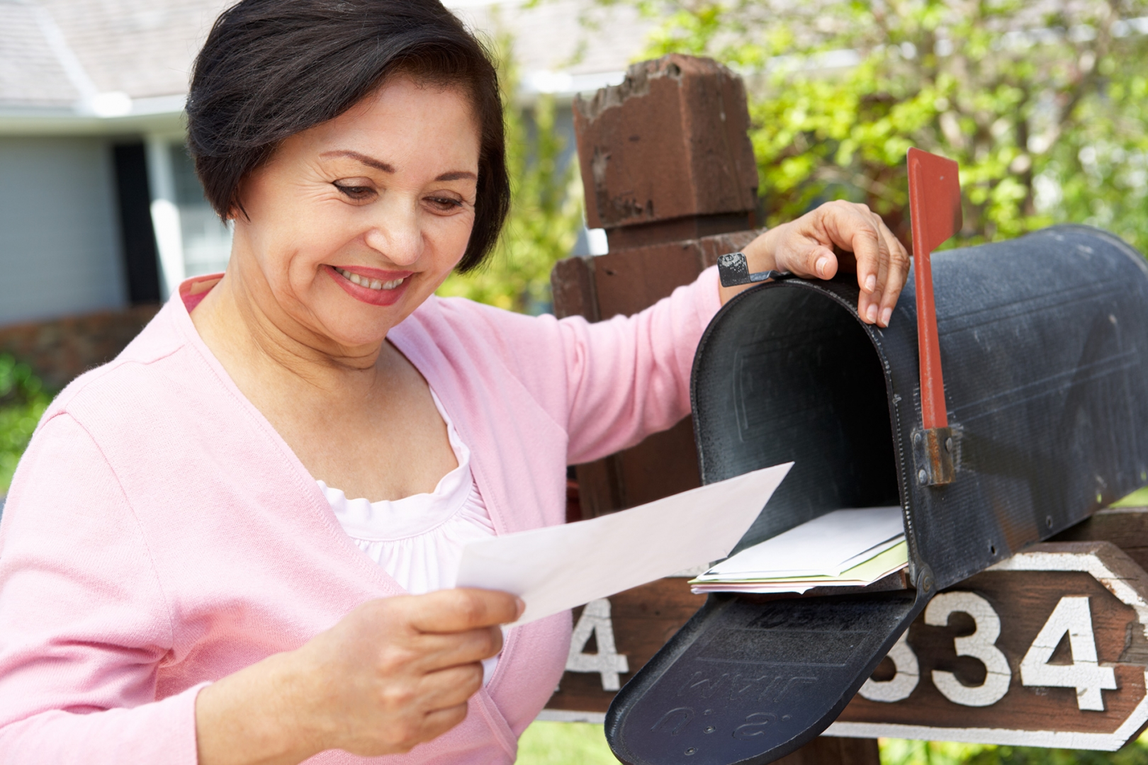 Woman looking at direct mail marketing piece