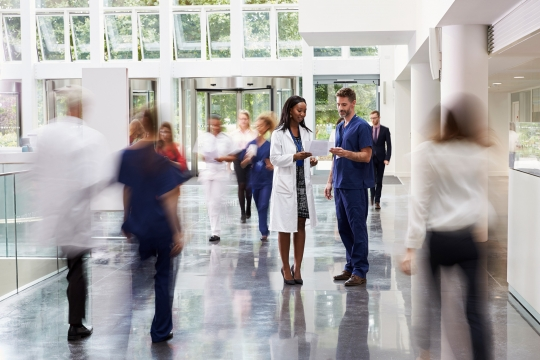 doctors reviewing patient analytics to forecast performance