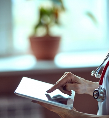 Woman with stethoscope on iPad