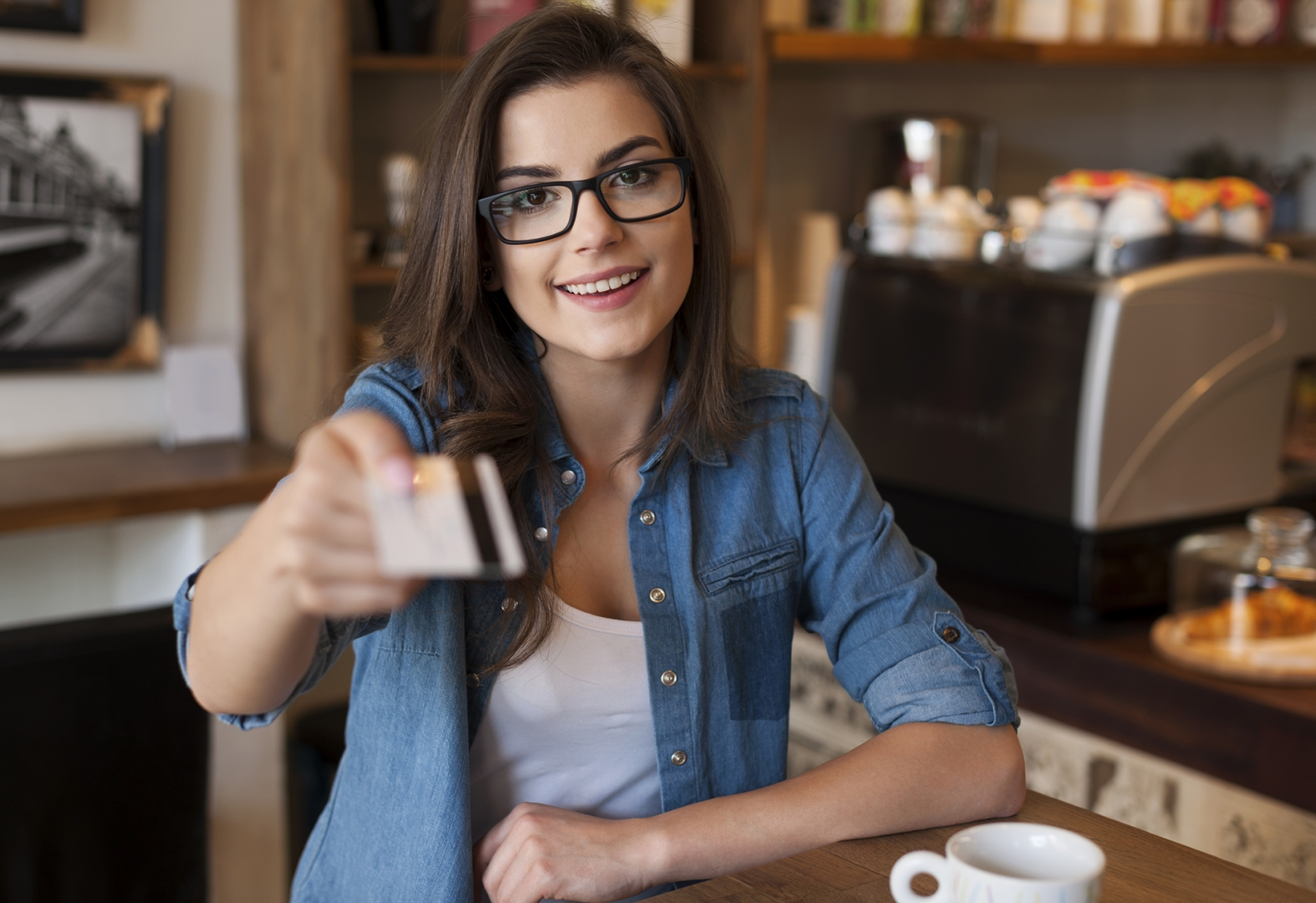 Girl holding credit card and smiling