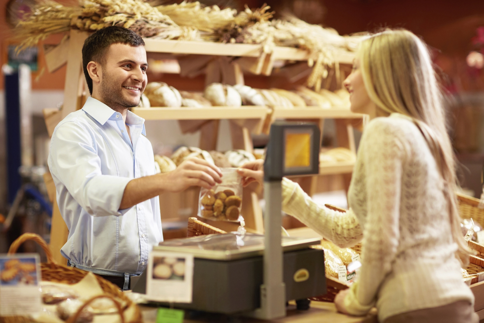 customer completing transaction with cashier at a bakery