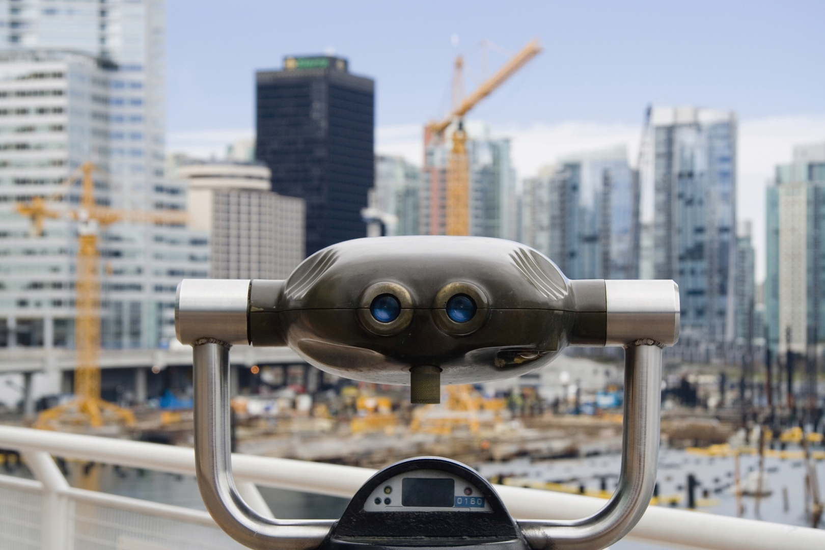 Binoculars overlooking construction in a big city