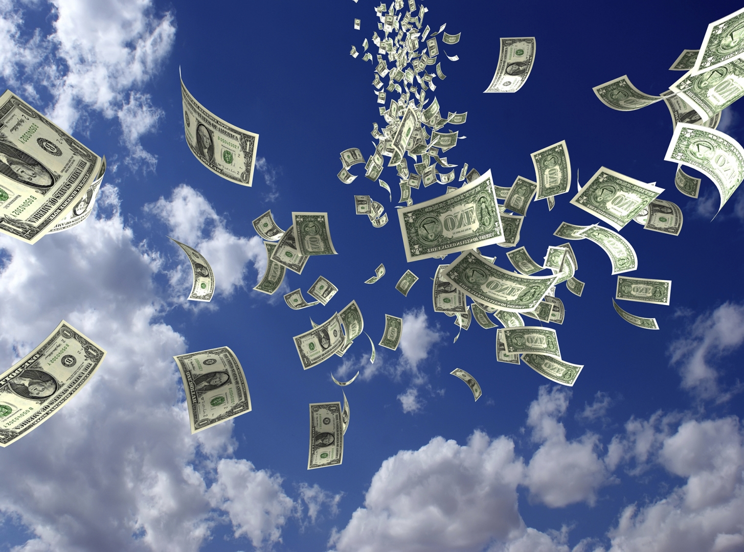 money tossed in the air with clouds