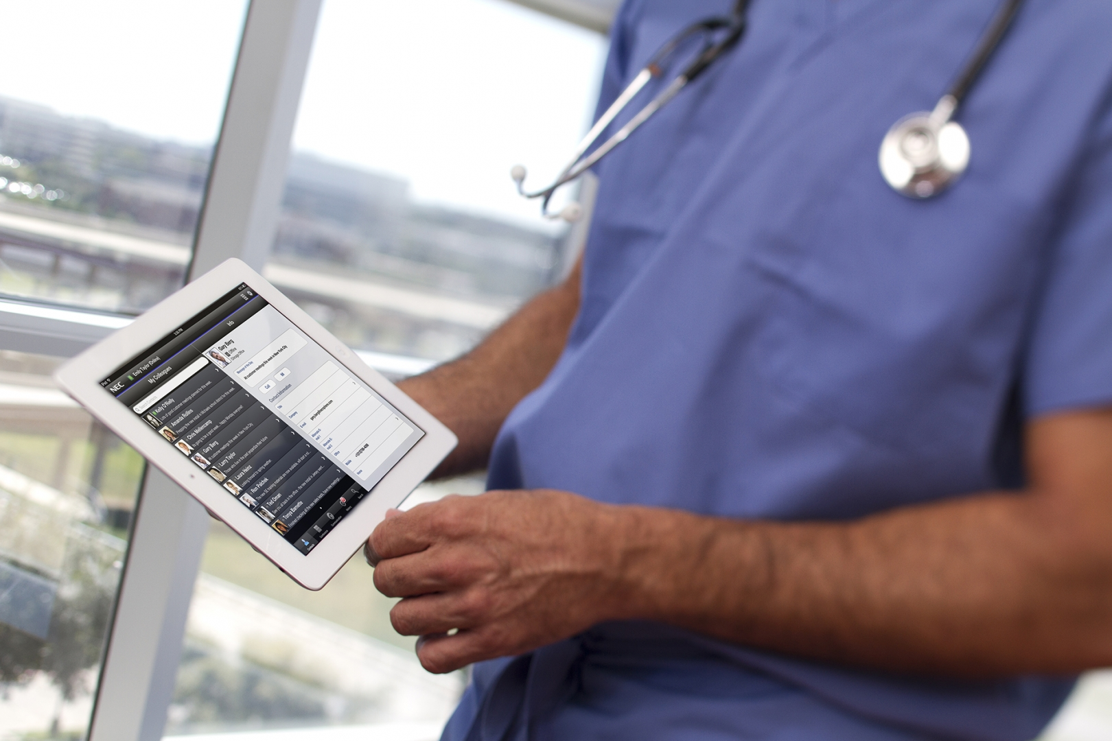 doctor holding tablet reviewing charts